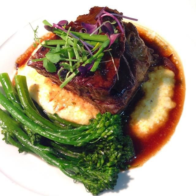 Slow Roasted Hudson Valley Short Ribs roasted local broccolini, wild hive creamy polenta, red wine braising jus