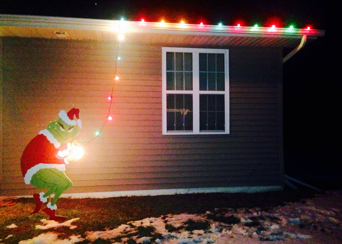 Grinch Christmas Lights.Grinch Stealing Christmas Lights Off The House Holidays