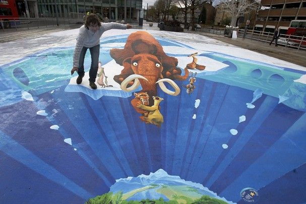 German Pavement Artist Edgar Mueller Poses With His Anamorphic - Anamorphic art looks real