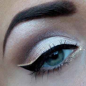 Strong brows. Silver in the crease. White on the lid. Cat eye. Glitter on the inner corners.