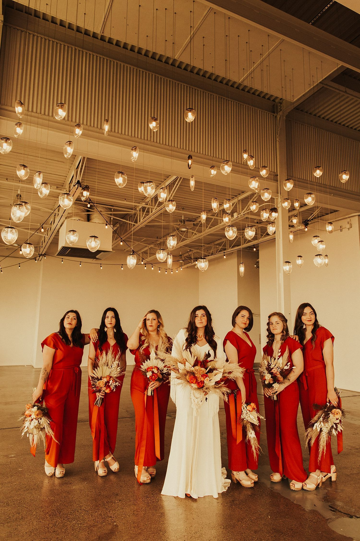 The Holden Room Wedding // Minneapolis, MN // Katy & Wyatt #bridesmaidjumpsuits Boho Wedding Party, Burnt Orange Bridesmaid Jumpsuits, Terra Cotta Wedding Colors, Pampas Grass Wedding Bouquet, Fringe Wedding Bouquet Holder, Boho Bridesmaids, Jumpsuit Bridesmaids #bridesmaidjumpsuits