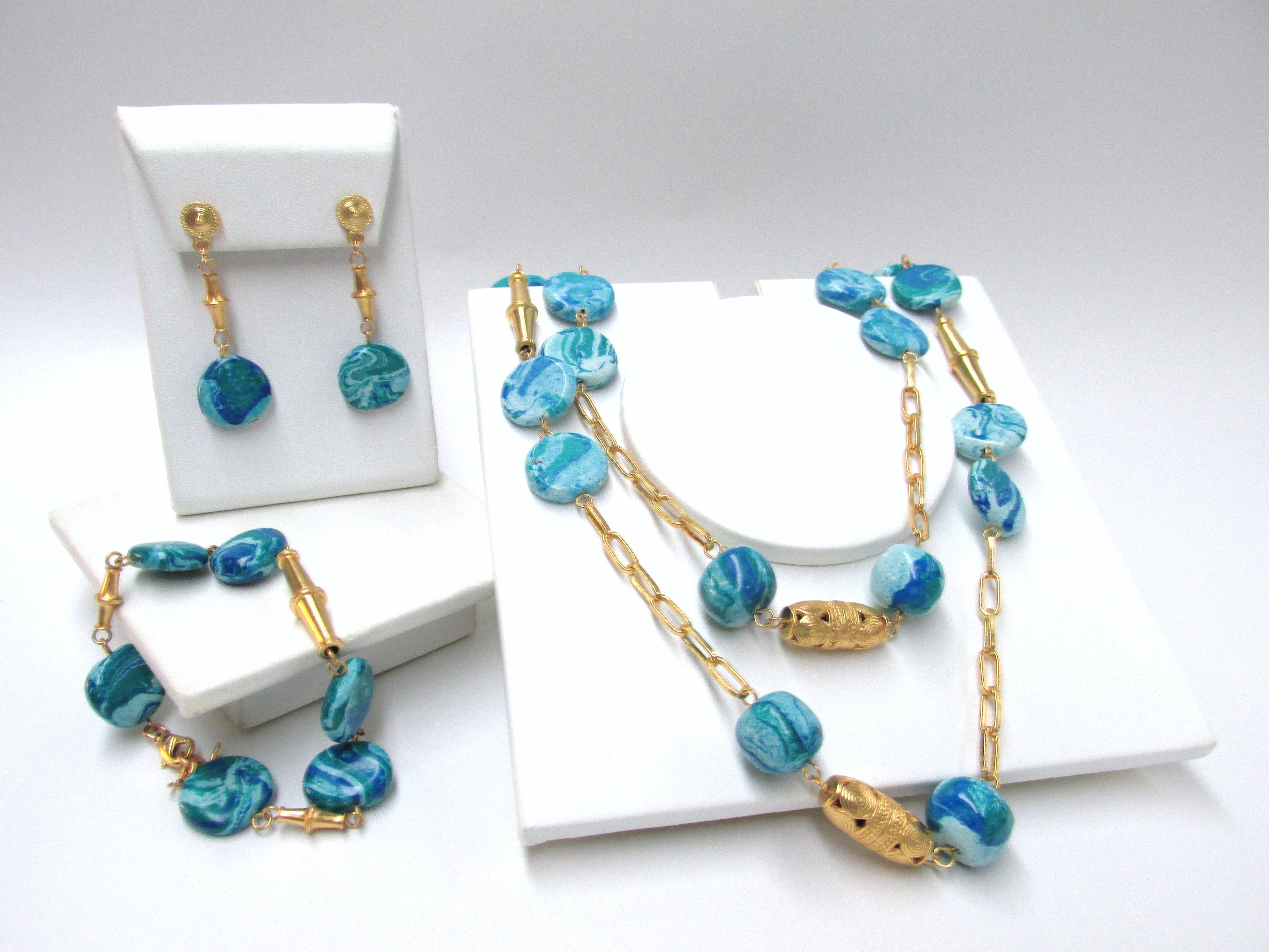 643357a7c2a1 Hermoso Juego de collar pulsera y aretes con piedra tairona agua marina y  enchape en oro