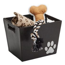 """Easily stow pet essentials with this playful storage bin, featuring bone-shaped handles and silver glitter appliques.    Product: ToteConstruction Material: Polyurethane and fabricColor: Dark brown and silverDimensions: 9.4"""" H x 11.5"""" W x 9.25"""" DCleaning and Care: Spot clean"""