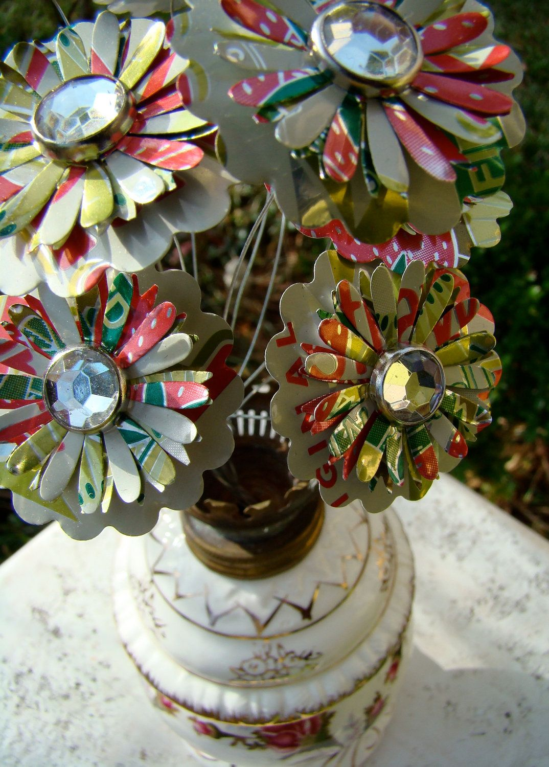 recycled tin flowers...cute, and they never die!