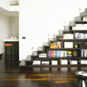 Long shelves under stairs.
