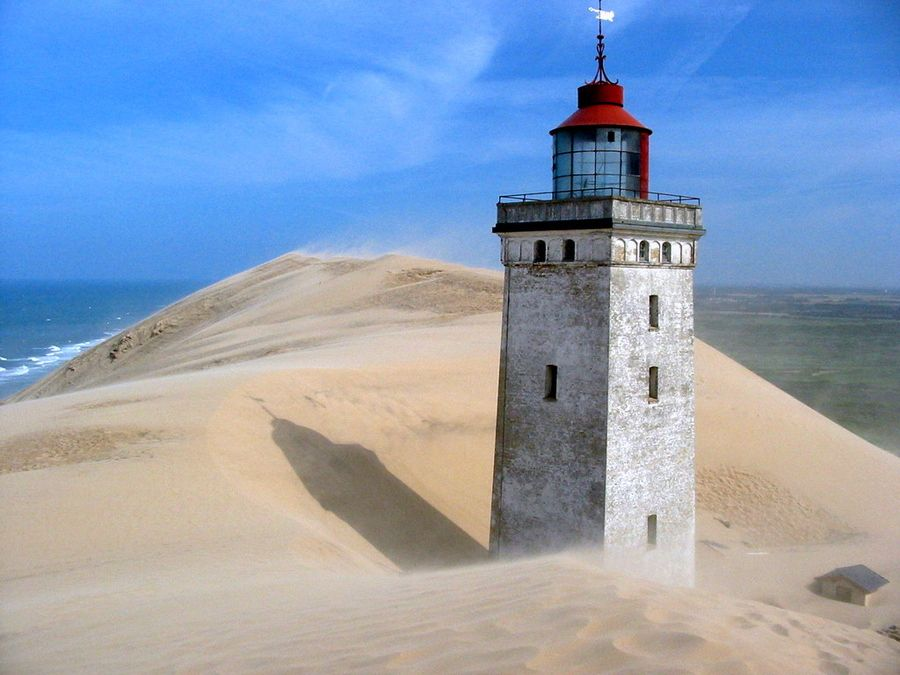 Lighthouse in Dune by Mathias Liebing, via 500px
