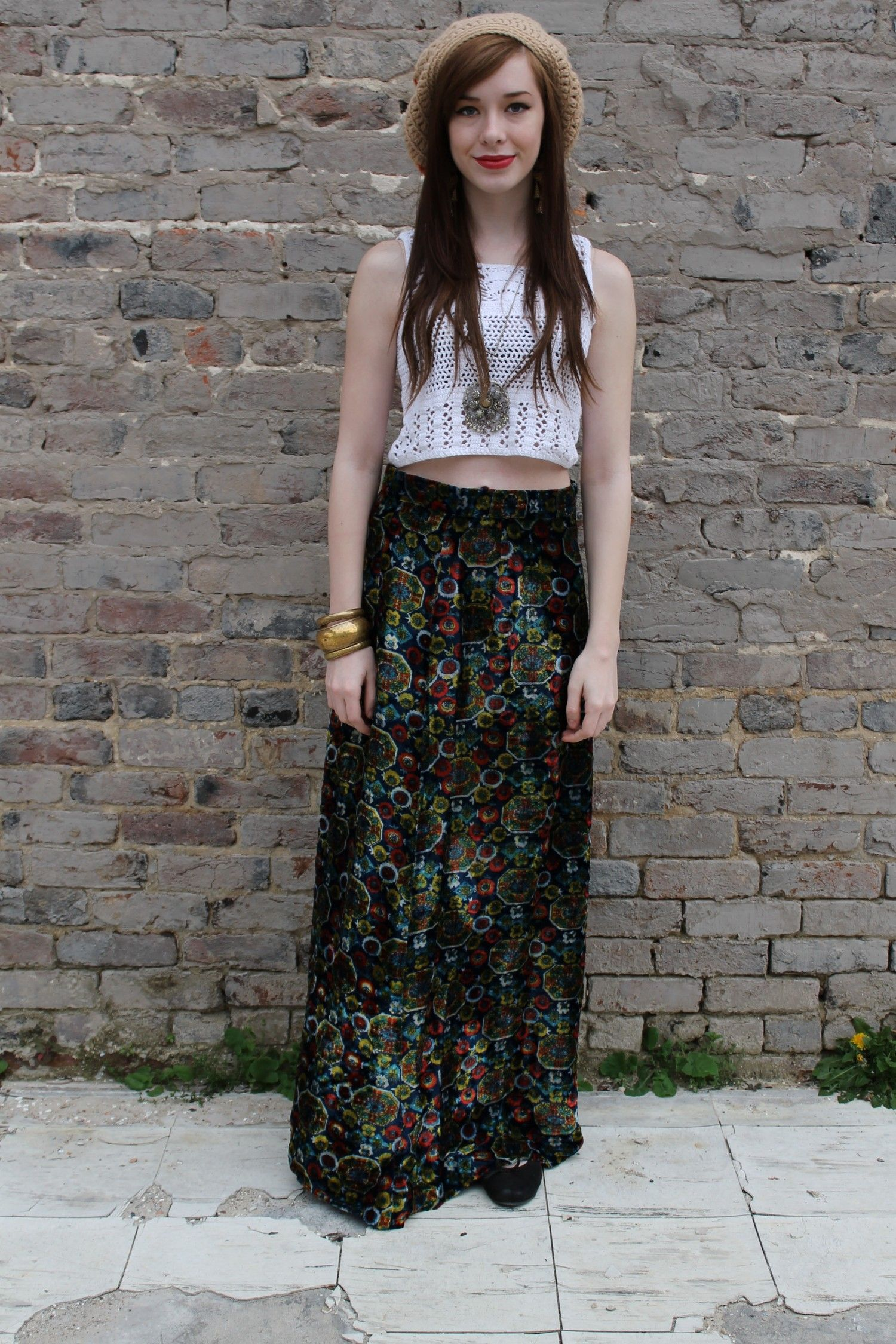 Long maxi skirt with crop crochet top & beige knitted cap so great to go & see a concert in. How about the Lollapalooza?