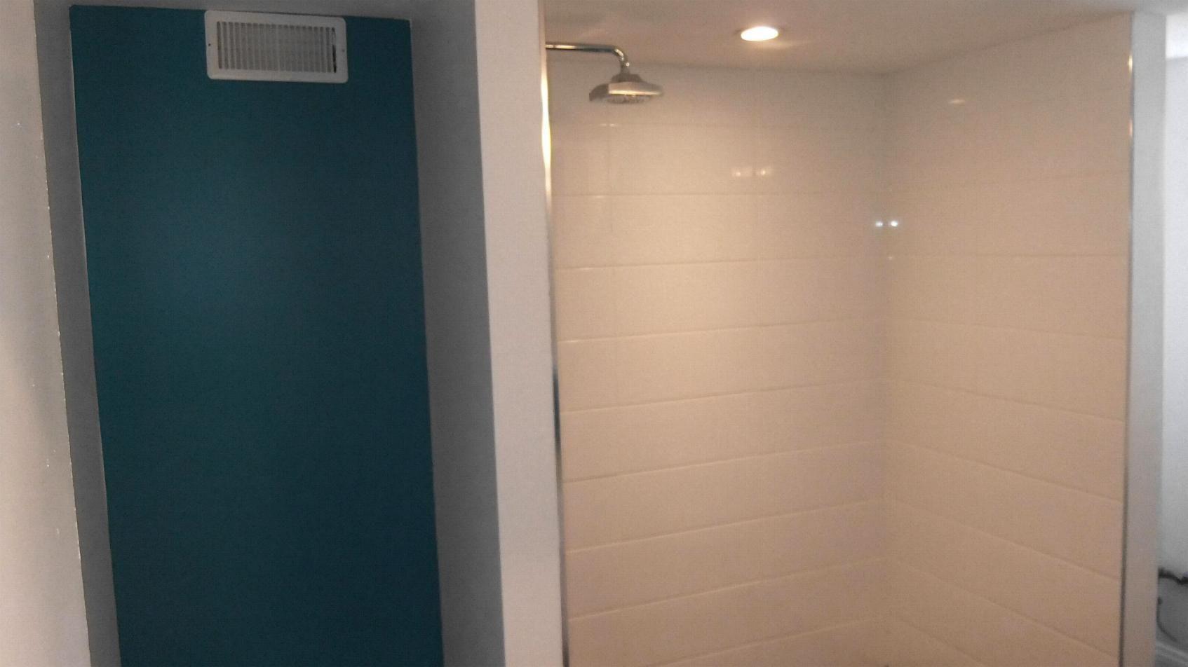 Shower Stall Lighting Is Installed