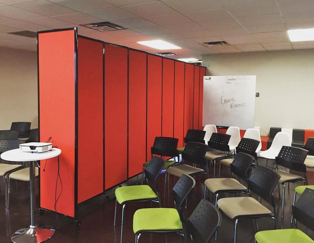 A wallmounted straightwall sliding partition wall for example