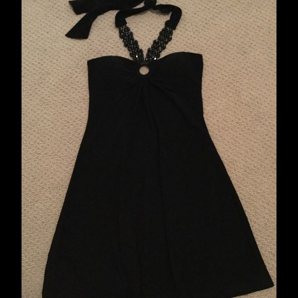Black dress with beads around the neck There is a padded bra.  Worn once.  I don't see a size on the dress.  It fits me and I am XS. Dresses Midi