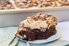 Reese's Poke Cake is an easy dessert recipe loaded with chocolate, peanut butter, and peanut butter cups! Perfect for parties and potlucks! #chocolatepeanutbutterpokecake Reese's Poke Cake is an easy dessert recipe loaded with chocolate, peanut butter, and peanut butter cups! Perfect for parties and potlucks! #chocolatepeanutbutterpokecake Reese's Poke Cake is an easy dessert recipe loaded with chocolate, peanut butter, and peanut butter cups! Perfect for parties and potlucks! #chocolatepeanutbu #chocolatepeanutbutterpokecake