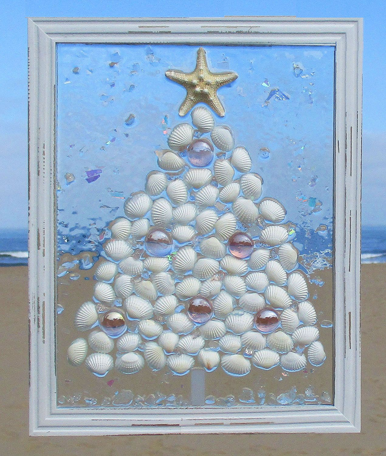 Unique Beach Window Art By Luminosities Christmas Tree Made Of White Shells Pink Gems Surrounded By S Sea Glass Art Projects Sea Glass Crafts Window Art Diy
