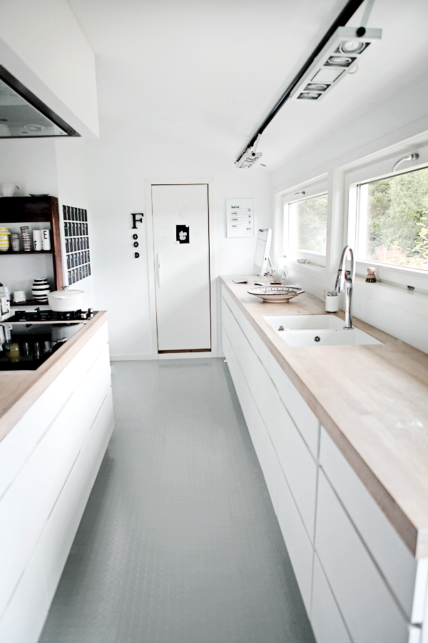 Grey Rubber Floor Against The White Units + Wood Countertops