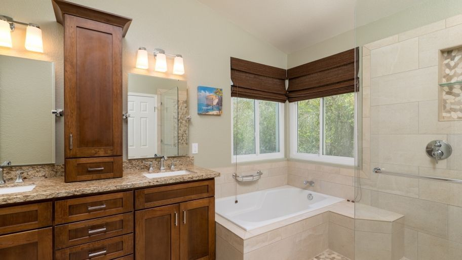 Remodeled Bathroom With Cabinets Tile And Tub Imagesoffancybathrooms Average Bathroom Remodel Cost Bathroom Remodel Cost Bathrooms Remodel