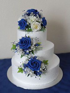 Three silk flower wedding cake toppers in royal blue and ivory indian weddings inspirations blue wedding cake repinned by indianweddingsmag indianweddingsmag weddingcake junglespirit