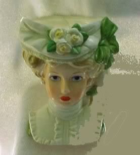 Pretty Victorian lady in green head vase Reminds me of my Granny. She collected these.