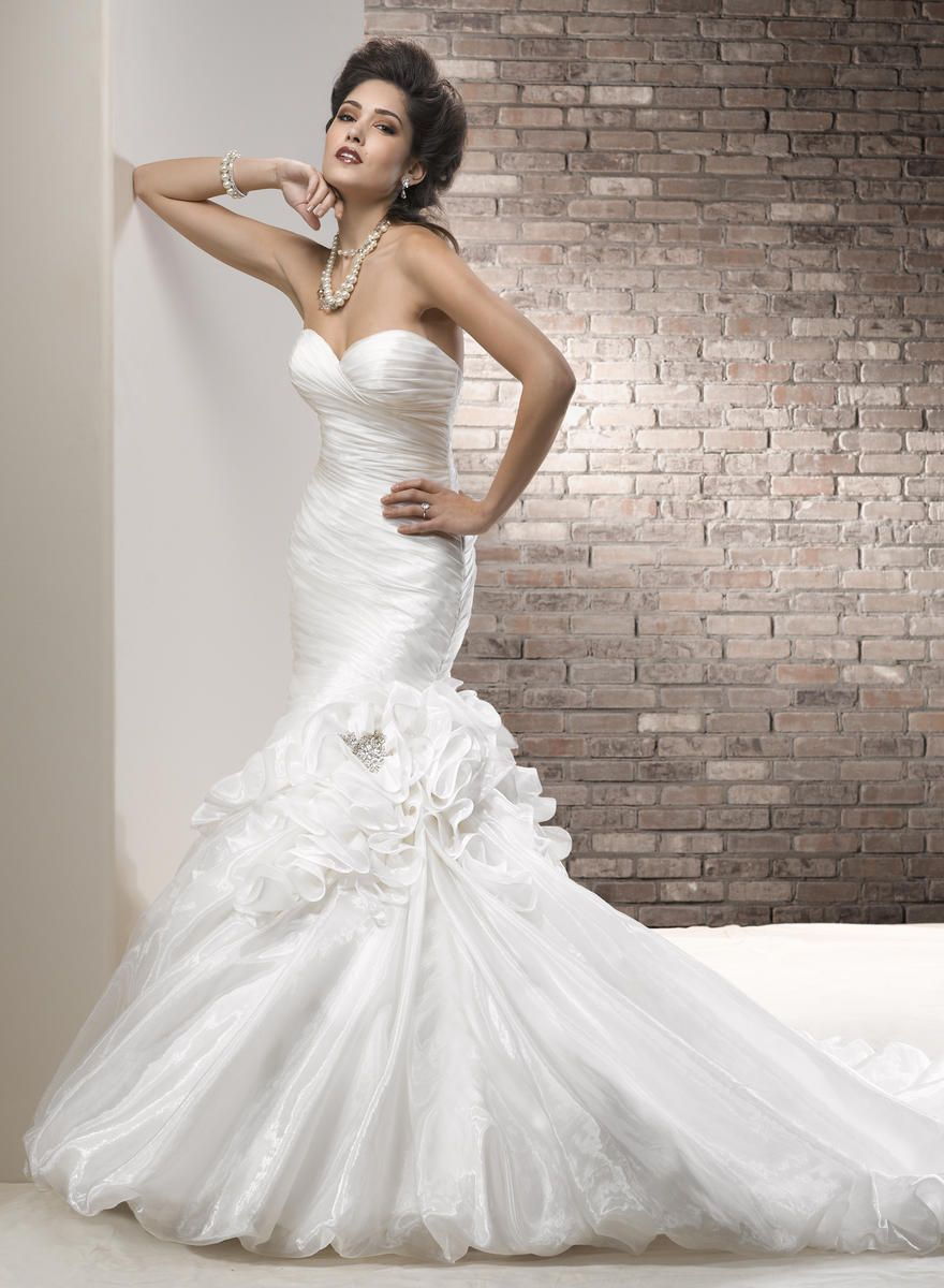 Beach wedding dresses mermaid style  Find at Casa di Bella Bridal Boutique in Celebration FL Fabric