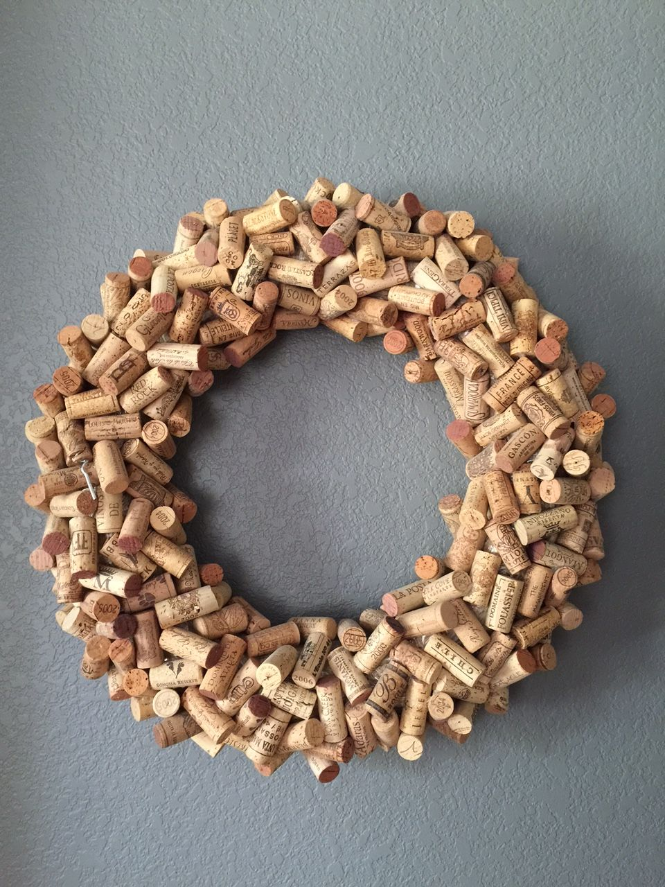 Cork wreath - indoor. Saved all sentimental corks popped at different times throughout the year, wrote the date on them and glued them onto the wreath. Best way to remember celebrations and big events!