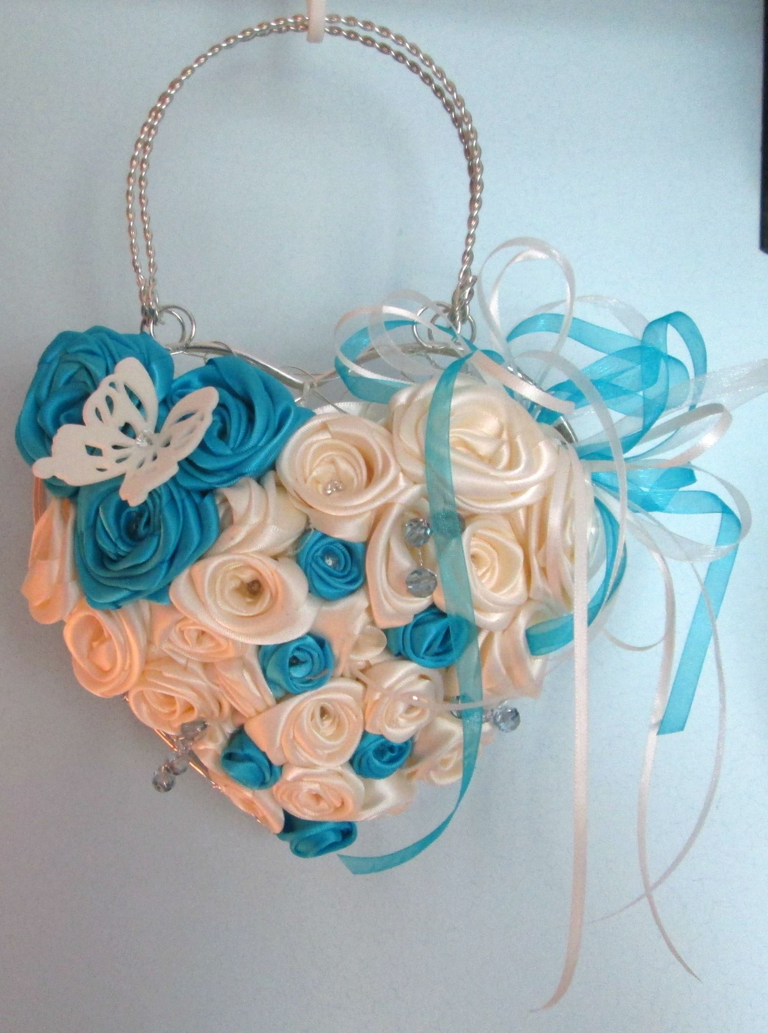 Handmade ivory and turquoise silk roses, presented in silver wire ...