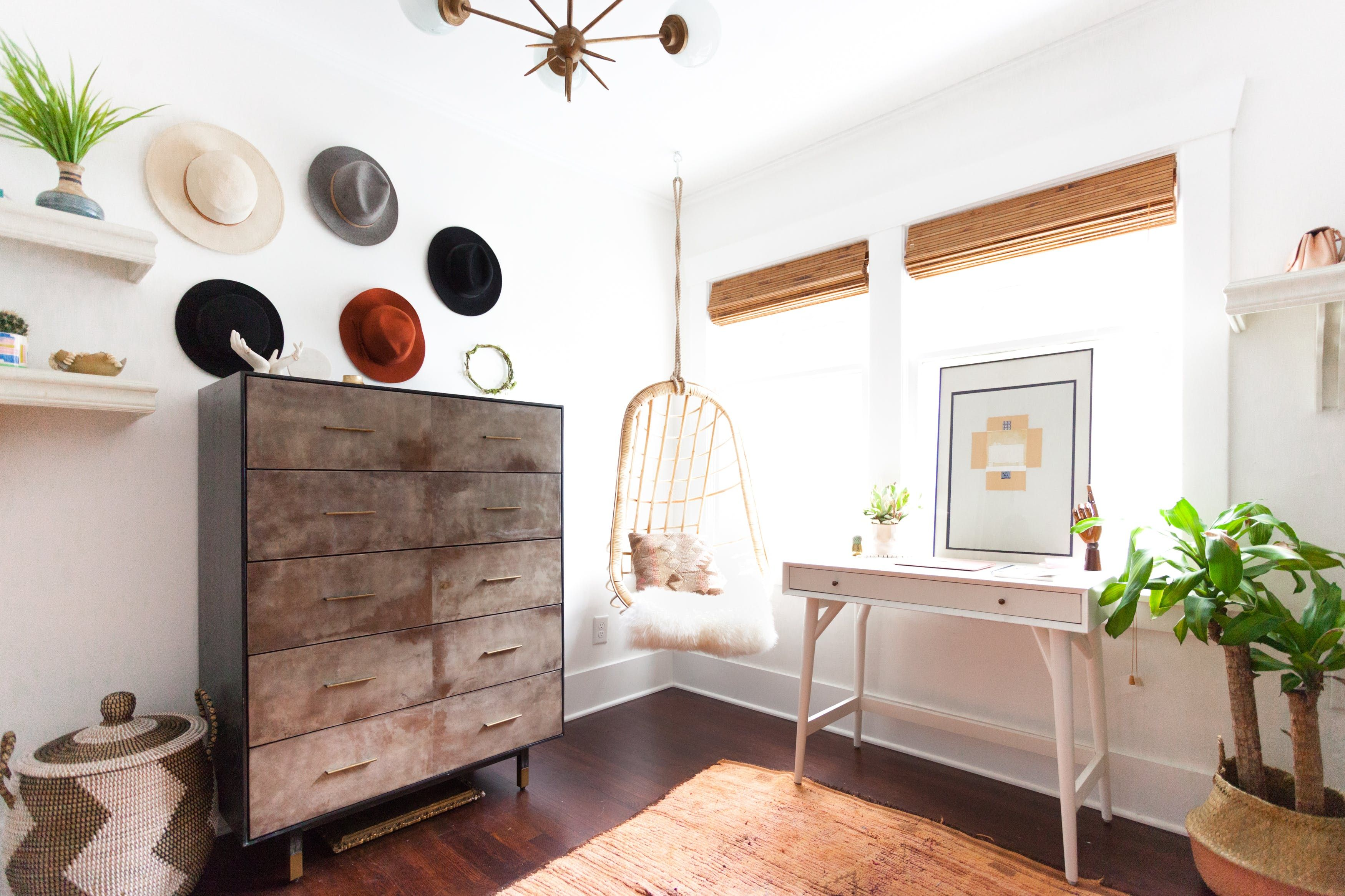 One of Hayley's favorite rooms in the house is the closet/office combo because the dual-use space took shape over time to fit her needs. Both the Shelly Chandelier by Currey and Company, and the Tall Sierra Chest are from The Mine.