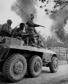 US infantrymen race to the Elbe river in an M8 Greyhound armoured car - Germany - April 1945
