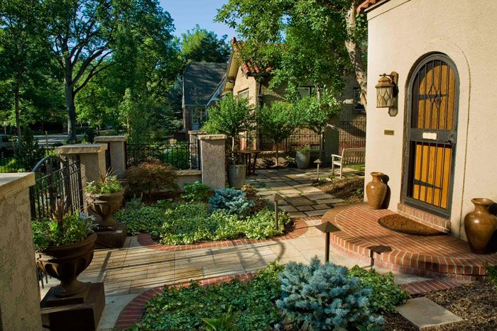 6 Tips To Create A Stunning Landscape In A Small Space Spanish Garden Curb Appeal Small Front Yard