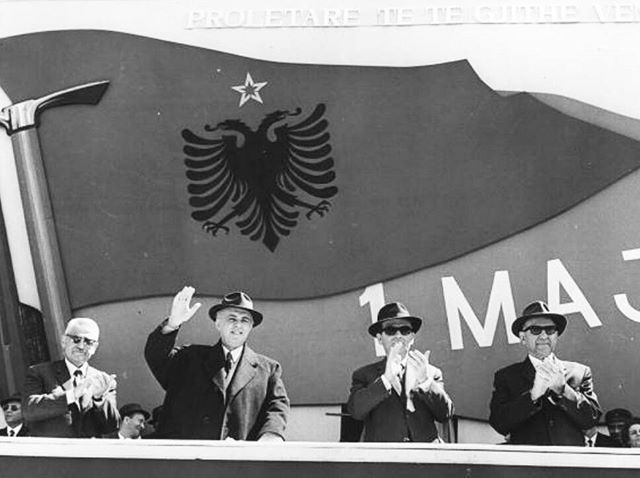 #Communist #officials from the ruling #Albanian #Party of Labour including #Enver #Hoxha, 2nd from left, wave and clap during national #celebrations.  #1973| Keystone