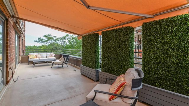 Amenities Include Two Terraces One With A Privacy Screen Of Greenery And Retractable Awnings