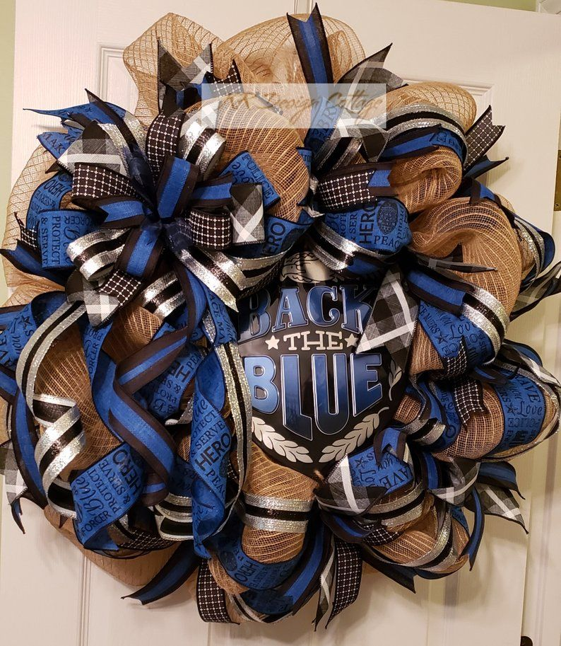 Photo of X-Large Back the Blue Deco Mesh Wreath, 18″ Wire Form but total approximate dimensions are 33″x32″x14″