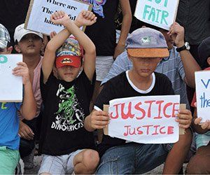Refugee children in Nauru take part in a protest in March 2015. © Private