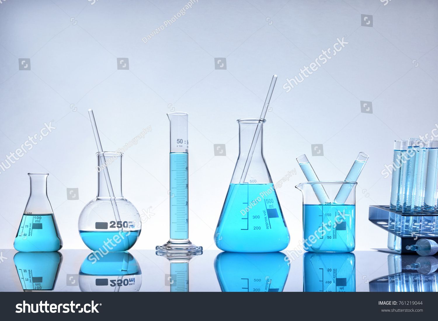 Laboratory Glass Chemical Containers Full Of Blue Liquid On Glass Table Isolated Horizontal Composition Front V Mandala Design Art Stock Photos Photo Editing