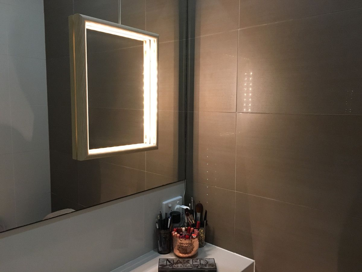 How to add light to poorly lit bathroom vanity mirror ...