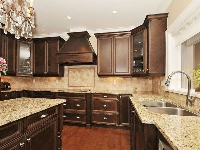 Traditional kitchen love the chocolate brown home for Brown kitchen cabinets with black granite