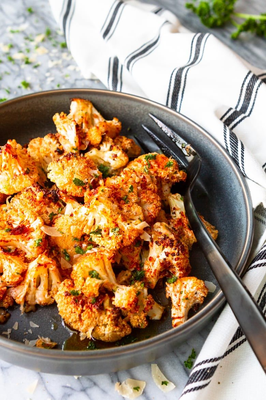 Smoky Garlic Parmesan Roasted Cauliflower -- this delicious Parmesan roasted cauliflower recipe is