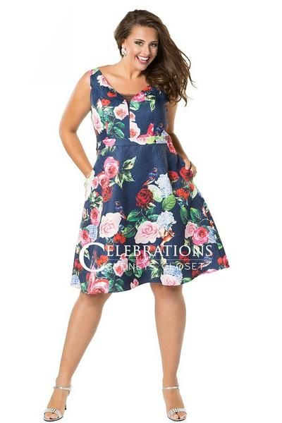af48bccfe ... wearing CE1806 in all over navy floral  short V-neckline party dress  with bra-friendly straps and pockets  photo shoot for PromGirl  plus size  floral