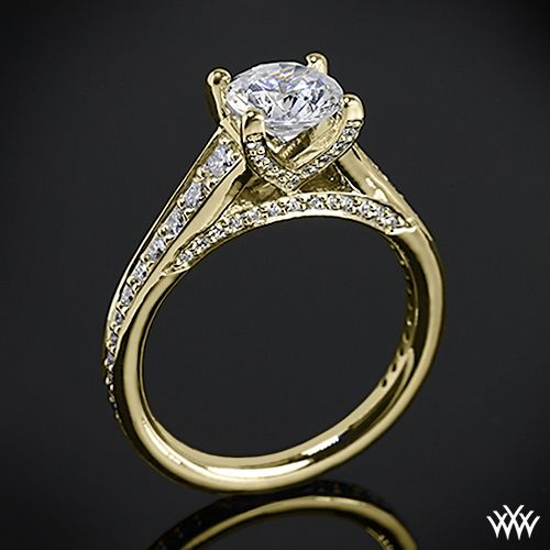 18k Yellow Gold Ritani Modern Graduated Diamond Engagement Ring from the Ritani Modern Collection. This beauty features a V pattern 4 prong head that will compliment the round diamond center of your choice.  The bead-set head, gallery and graduating shank sparkle with Round Brilliant Diamond Melee