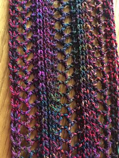 I have knit this scarf using needle sizes 10.5, 11, and 13. Try knitting a swatch to find your preference.