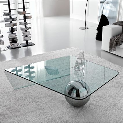 Modern Italian design is represented by Globe Glass Coffee table  A curved  minimalist table.