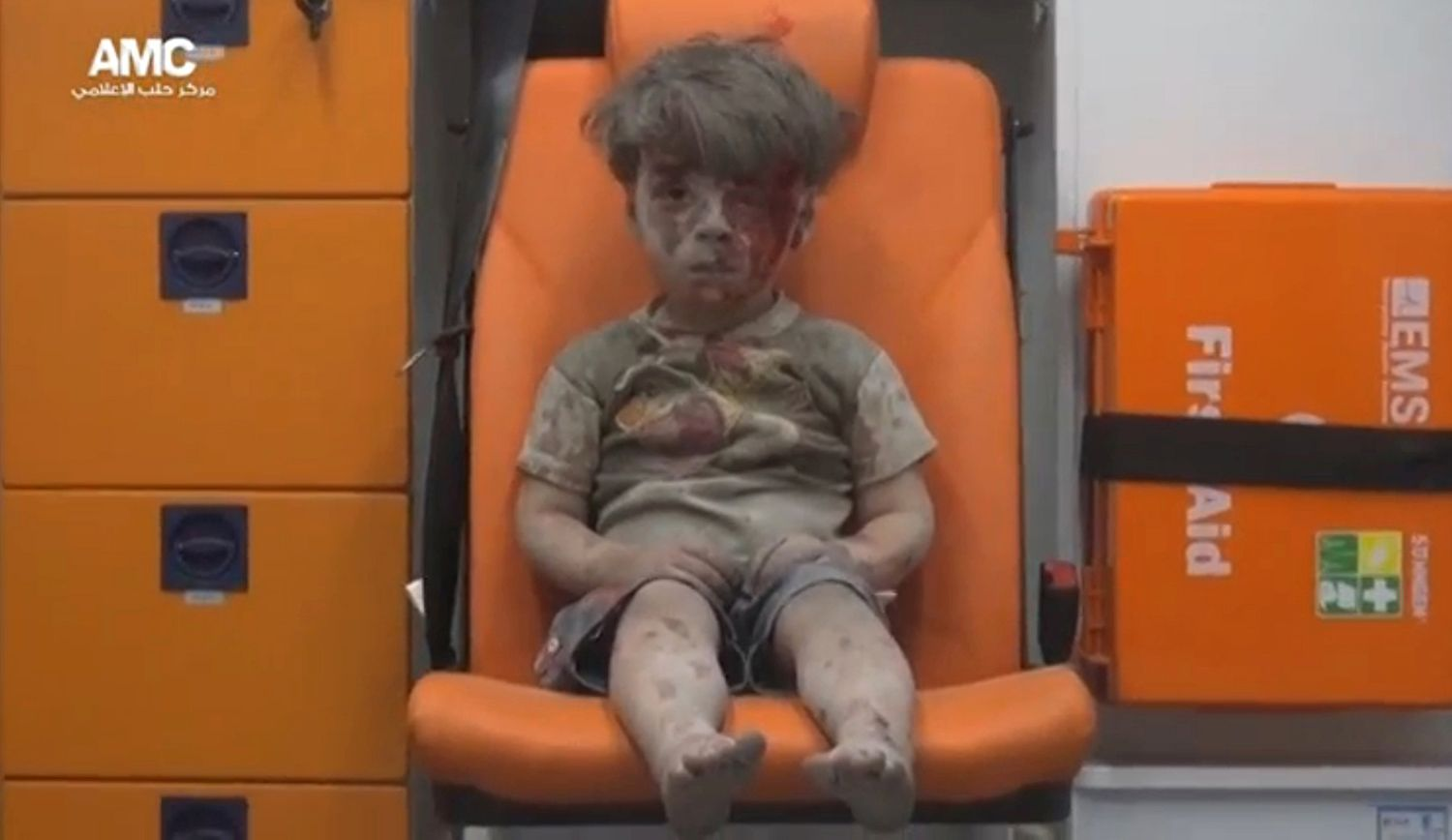 A still image taken on August 18, 2016 from a video posted on social media said to be shot in Aleppo on August 17, 2016, shows a boy with bloodied face sitting in an ambulance, after an airstrike, Syria.