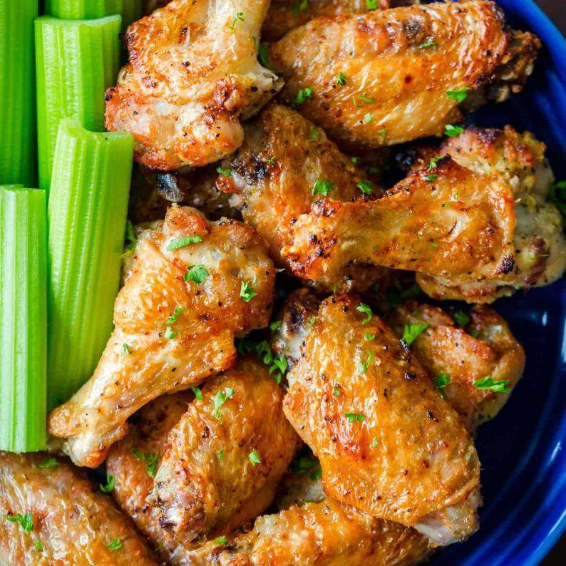 Air fryer chicken wings in bowl with celery air fryer