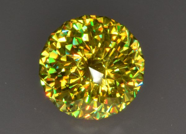 "Extremely rare greenish yellow color and incredible dispersion! Fantastic stone for best gem collections!   Weight: 	7.02 ct Size: 	10.7 x 10.7 x 7.8 mm Color: 	greenish yellow, with flashes of green, red and orange due to dispersion Clarity: 	nearly eye-clean, some very small inclusions very hardly visible to the naked eye Cut:	""Marcoh-i-noor"" design by Marco Voltolini, precision faceting quality, faceted by Egor Gavrilenko."