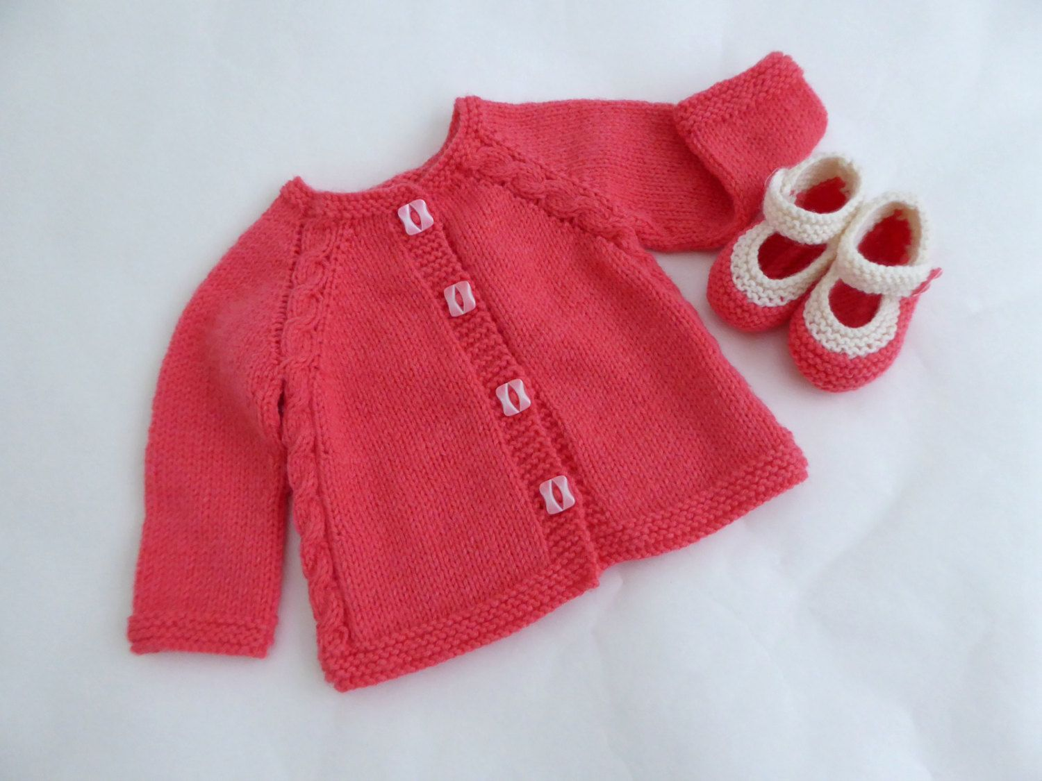 A sweetly simple baby set in a beautiful coral pink colour. This ...