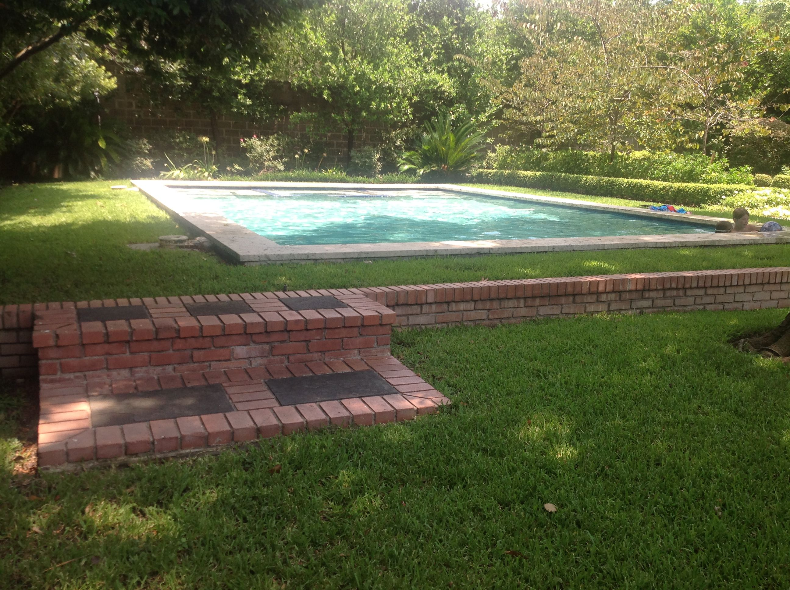 split level backyard with nice classic pool for the home