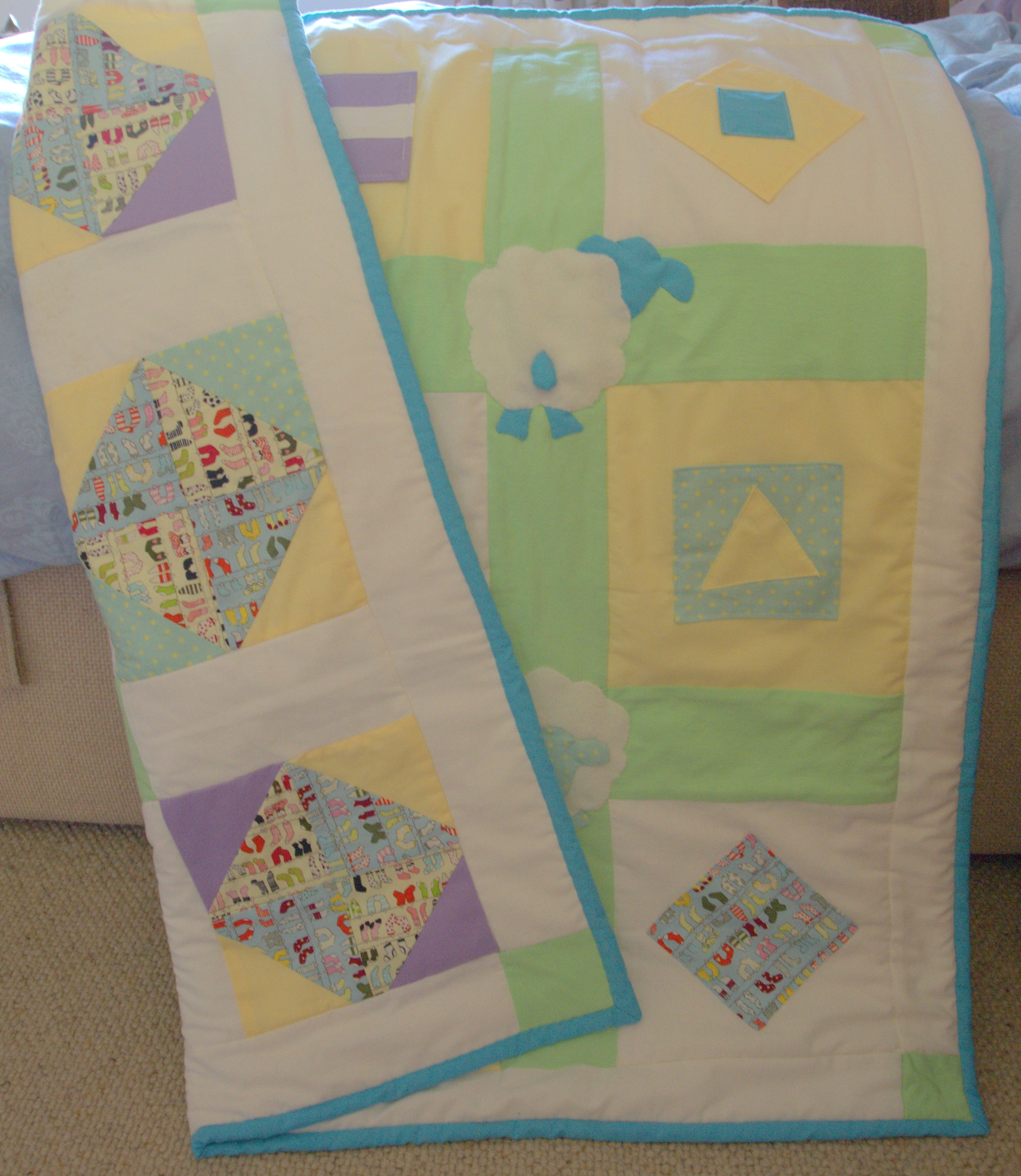 This is the first quilt I made in June 2015 for my friend's first baby.