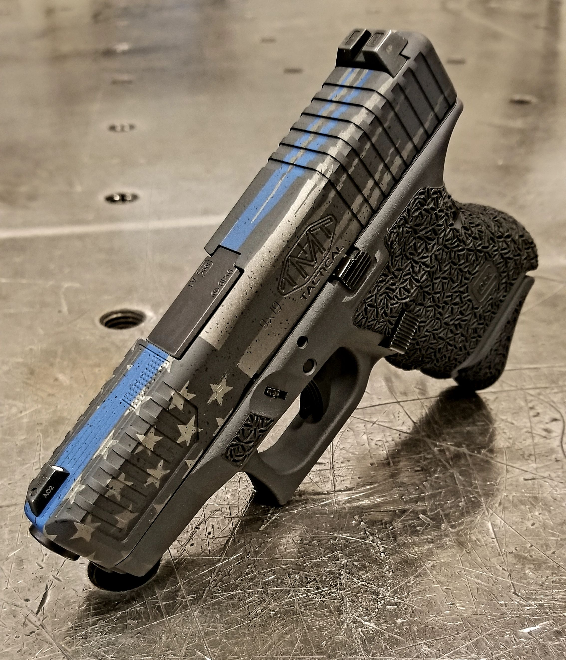 Thin blue line Glock 26  Cerakote, stipple, and machined cocking