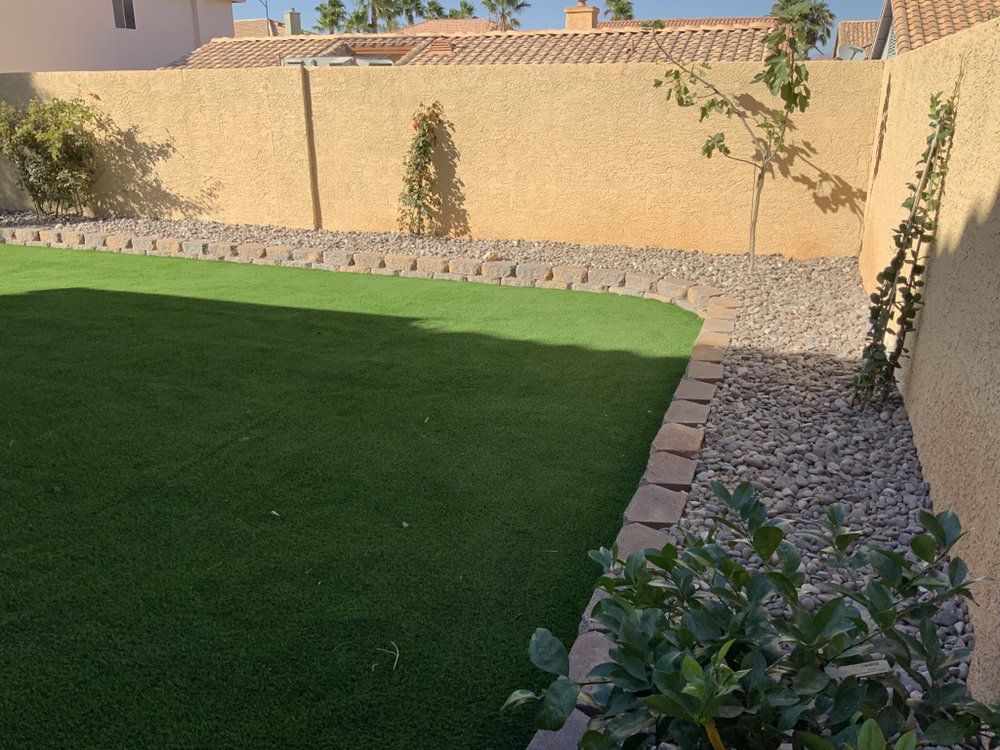Artificial Turf And Retaining Wall Yelp In 2020 Landscaping Las Vegas Backyard Landscape