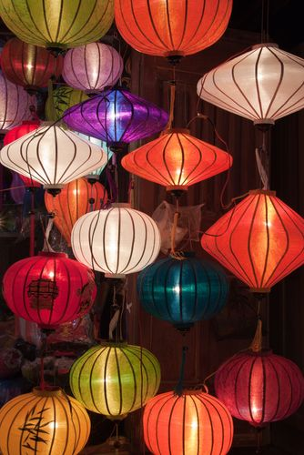 one of the numerous colorful paper lantern shops in hoi an vietnam