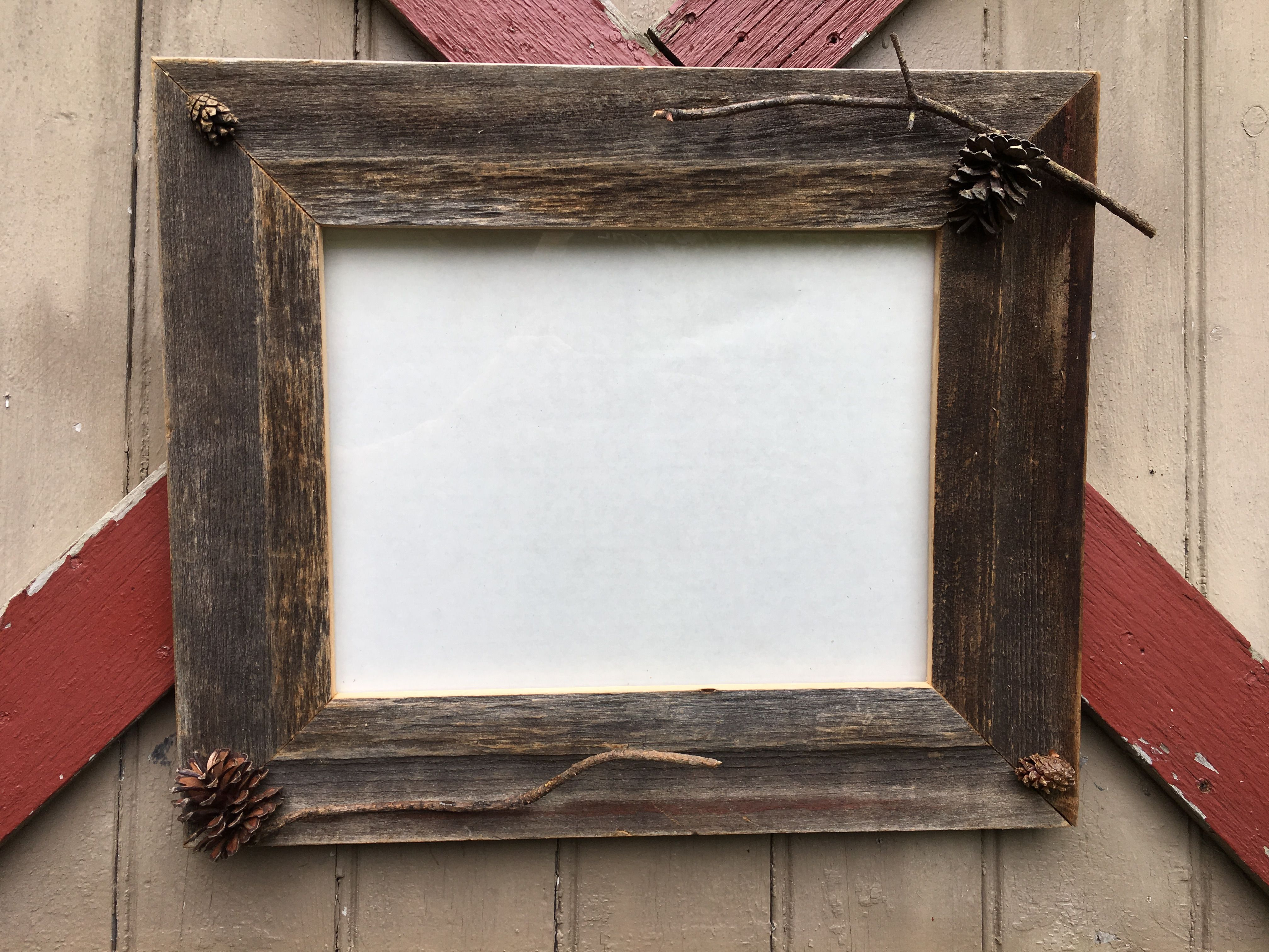 This picture frame holds an 11x14 picture. This frame is made with ...