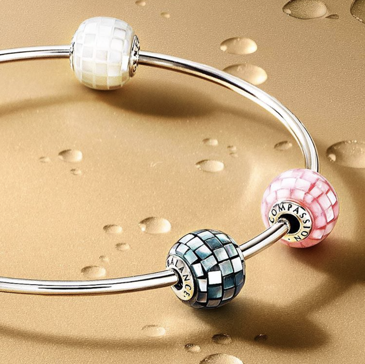 ccf313592 Pandora's new Essence Mosaic Mother of Pearl charms have arrived. Visit us  to see the new Compassion, Generosity and Balance.