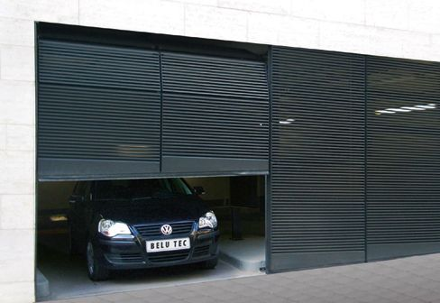 Designer garagentor  Belu Tec flush garage door in metal. Looks like sectional door ...